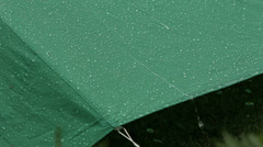 Rain falling on a green tent, with sound Stock Footage