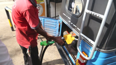 Local man putting petrol in tuktuk in Weligama, Sri Lanka. Stock Footage