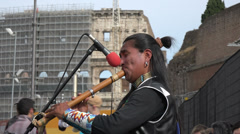 Italy, Rome, south american indian, perfoming folk songs near Colosseum. Stock Footage