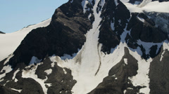 Aerial view mountain ridges summer snow, Alaska - stock footage