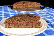 Stock Photo of gingerbread cake with red currant filling on plate