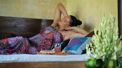 Woman resting and lying on bed Stock Footage