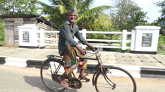 Local man riding bicycle in Weligama, Sri Lanka. Stock Footage