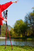Nordic walking. red sticks on grass in park Stock Photos