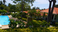 Summer Landscape Panorama. Azure Private Pool next to Tropical Island Villa. Footage