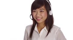 Asian telemarketer Stock Footage