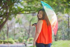 Happy fatty woman with umbrella Stock Photos