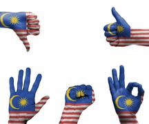 hand set with the flag of malaysia - stock photo