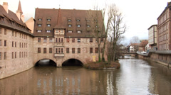 Historic medieval buildings on river Pegnitz in Nuremberg Stock Footage