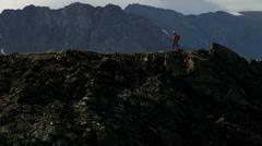 Aerial view male mountain climber ridge walking, Alaska, USA - stock footage