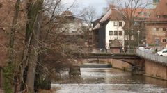 Historic medieval buildings on river Pegnitz in Nuremberg, zoom out Stock Footage