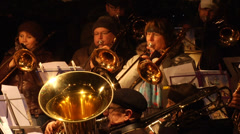 Brass band playing at the christmas market in Nuremberg, Germany, close-up Stock Footage