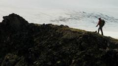 Aerial male mountain climber ridge walking, Alaska, USA - stock footage