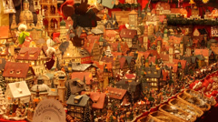 A stall with house miniatures at the Weihnachtsmarkt in Nuremberg. Steady shot. Stock Footage