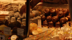 Sweets stall with pralines and pastries at the Christmas market in Vienna pan. Stock Footage