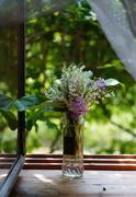 bouquet with lilies of the valley on the windowsill - stock photo