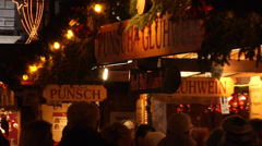 People drinking traditional spiced hot wine at the Christmas market in Vienna. Stock Footage