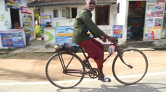 Local man riding bicycle in Weligama, Sri Lanka. Stock Footage