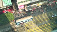 Arial Time lapse busy street, people and vehicles Tsim Sha Tsui (TST) Hong Kong Stock Footage