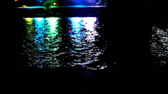Colorful light reflect on the water at night. Video shift motion Stock Footage
