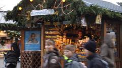 Pan of crowds at Vienna Rathausplatz Christmas market Stock Footage