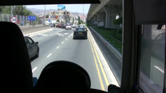 Coach joining traffic queue on a busy road in Cyprus Stock Footage