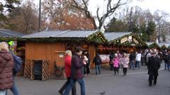 Zoom in of crowds at Vienna Rathausplatz Christmas market Stock Footage