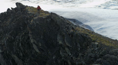 Stock Video Footage of Aerial view male mountain climber ridge walking, Alaska, USA