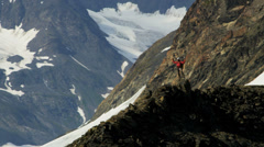 Aerial Top of the World view of successful Peak climber, Alaska, USA - stock footage