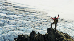 Aerial view of triumphant climber remote wilderness,  Alaska, USA Stock Footage
