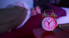 Sleeping at night alarm clock Stock Footage