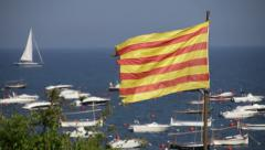 Catalonia flag in the seashore with boats 03 Stock Footage