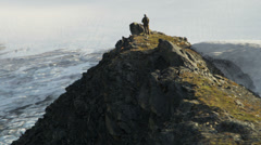 Aerial view of high Peak climber achieving success Alaska - stock footage