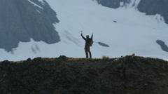 Stock Video Footage of Aerial view of triumphant climber remote wilderness,  Alaska, USA