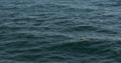 4K, flying over the ocean, waves forming, sparkles and wakes Stock Footage