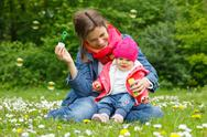 Stock Photo of Mother with baby in the park