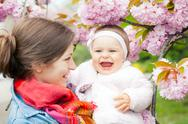 Stock Photo of Mother with baby in the garden