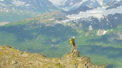 Aerial view of male mountain climber in summer, Alaska, USA - stock footage
