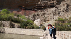 Tourists at hanging temple monastery in datong china Stock Footage