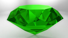 Emerald green gemstone gem stone spinning wedding background loop Stock Footage