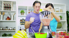 Health Conscious Asian Chinese Couple Making Organic Fruit Drink - stock footage