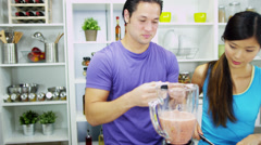 Healthy Ethnic Couple Homemade Smoothie Together - stock footage