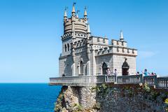 tourists walking near the castle swallow's nest - stock photo