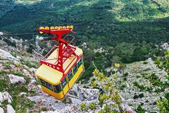 Ropeway in yalta leading to the top of ai-petri mountain, crimea Stock Photos