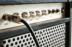 Guitar amplifier with jack cable Stock Photos