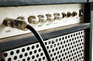 Stock Photo of guitar amplifier with jack cable