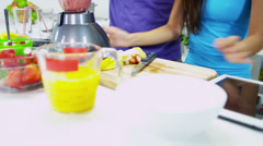 Young Ethnic Couple Using Blender Organic Fruit Drink - stock footage