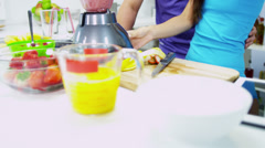 Multi Ethnic Male Female Kitchen Blender Fresh Fruit Juice - stock footage