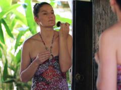 Woman improving makeup in bathroom Stock Footage