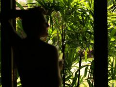 Silhouette of Woman drinking in the garden Stock Footage